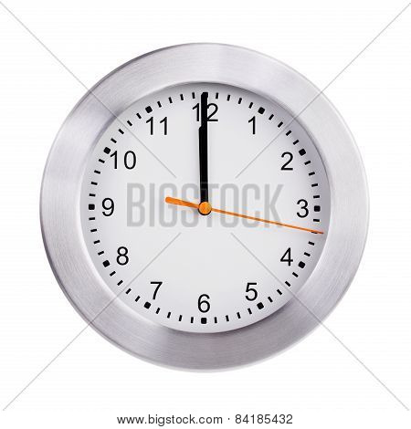 Noon on the dial of the large round clock stock photo