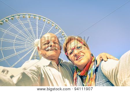 Happy Retired Senior Couple Taking Selfie At Travel Around The World - Active Playful Elderly