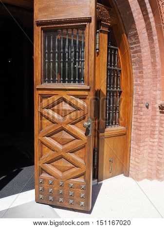 beautiful old ornate wood doors found on the campus of Flagler College in St. Augustine Florida. The style of the building is Spanish Renaissance. stock photo