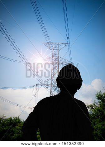 tower for electricity in rural landscape under blue sky stock photo