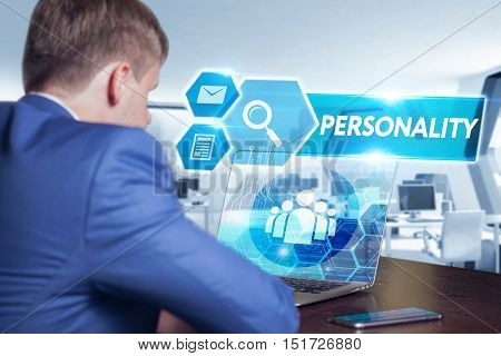 Business technology internet and networking concept. Young businessman working on his laptop in the office select the icon personality on the virtual display. stock photo