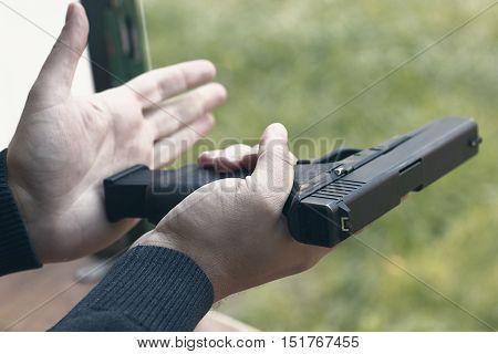 Loading Handgun. Reloading handgun. Loading pistol. Reloading. stock photo