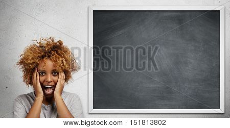 Human Face Expressions And Emotions. Scared And Frustrated Dark-skinned College Student Screaming Wi