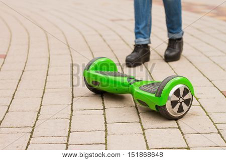 Girl riding electric mini segway. Ecological city transportation on battery powerproduces no air pollution to atmosphere.Self balancing scooter board stock photo