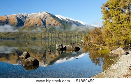 Alpine Lake Reflection.  Nelson Lakes National Park, Southern Alps, New Zealand. stock photo