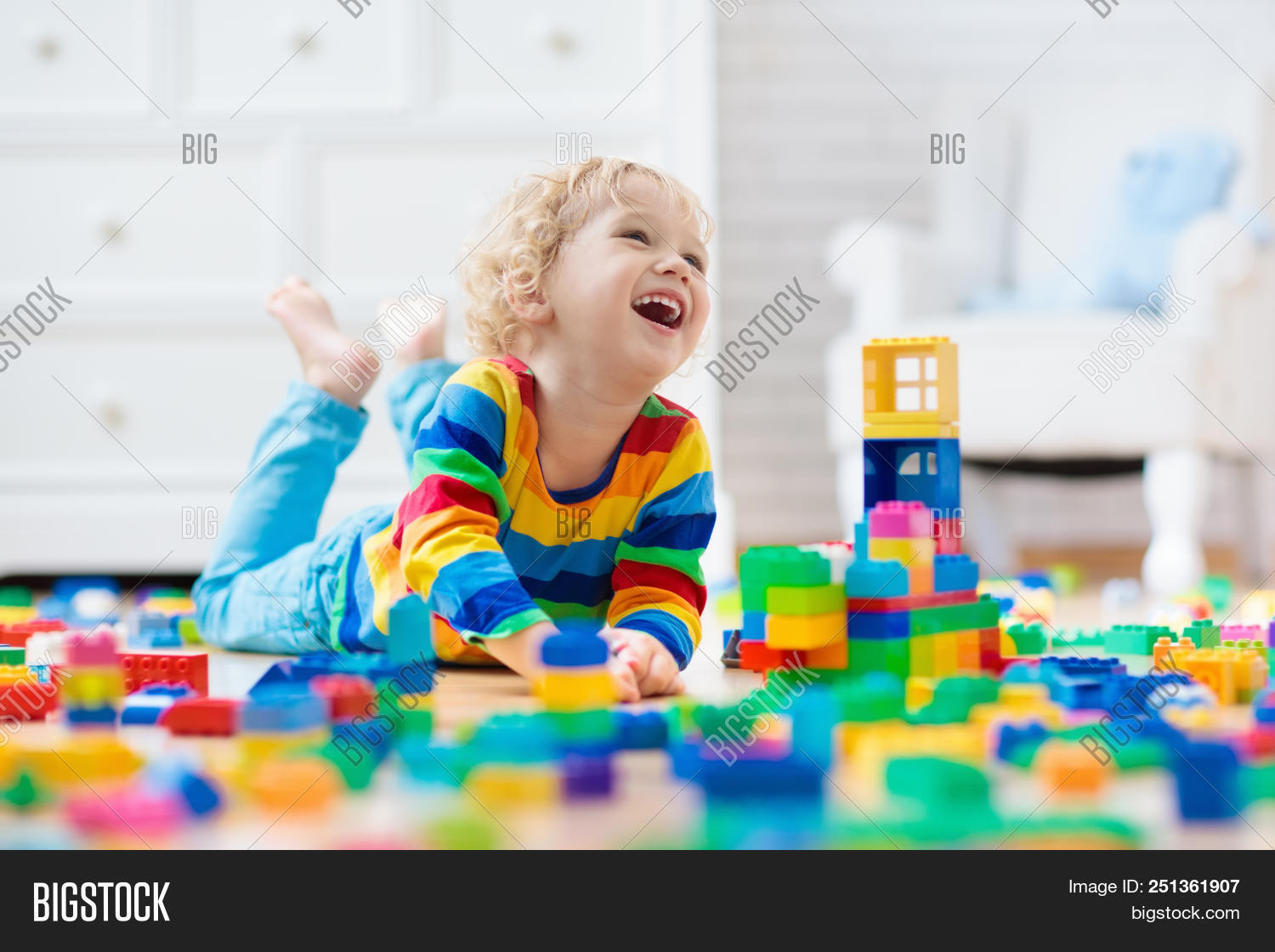 baby,block,blond,boy,bricks,build,building,care,child,childcare,childhood,children,color,colorful,construction,creative,cute,day,daycare,development,education,educational,elementary,floor,fun,funny,game,home,house,interior,kid,kindergarten,learning,little,mess,nursery,plastic,play,playing,preschool,preschooler,rainbow,room,toddler,tower,toy,white
