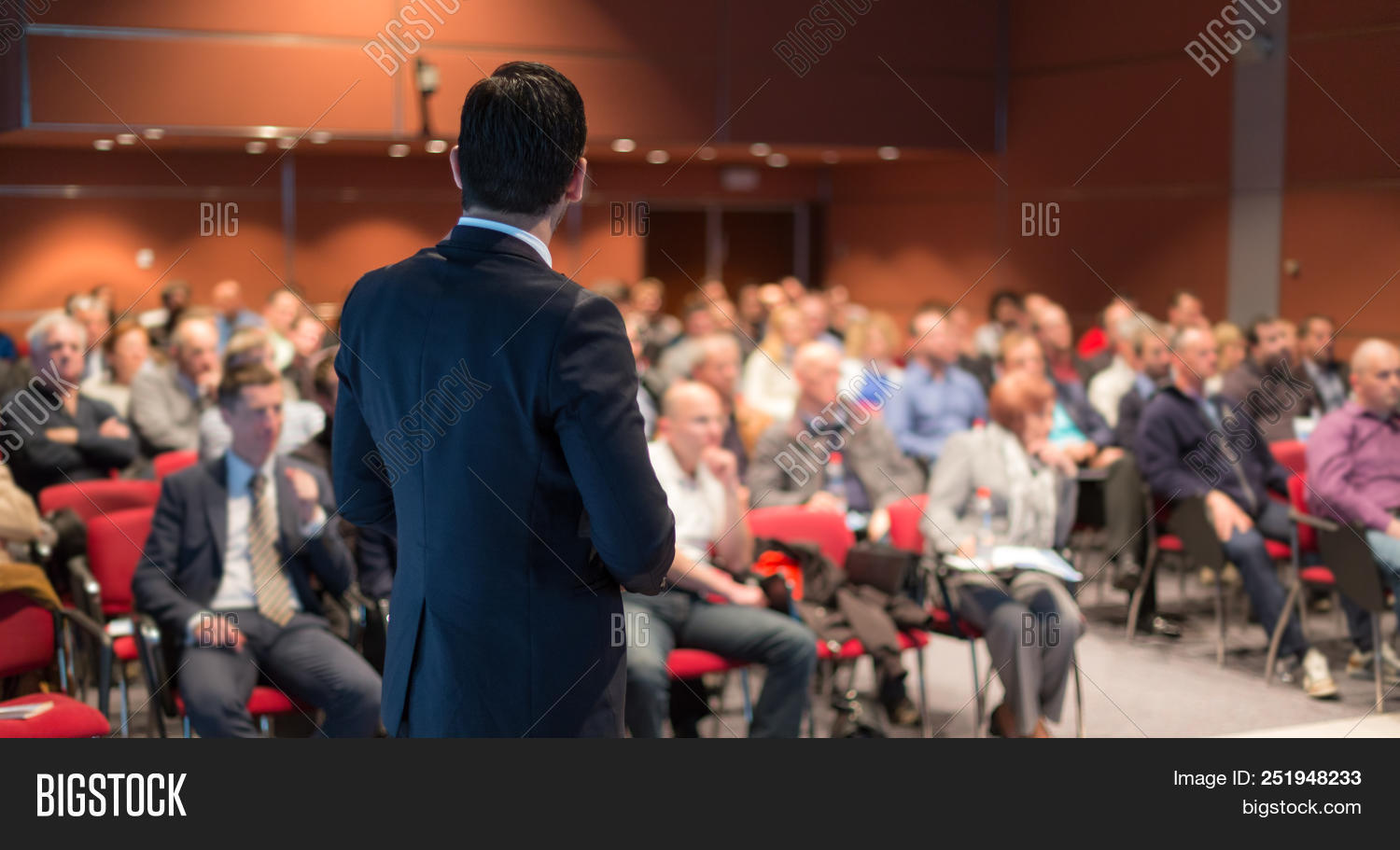 academic,audience,business,businessman,center,ceo,coaching,conference,congress,convention,cooperation,corporate,education,educator,entrepreneur,entrepreneurship,event,explaining,group,hall,indoors,information,institute,knowledge,leader,learn,lectern,lecture,male,man,manager,meeting,participants,people,podium,presentation,professional,public,rostrum,seminar,speaker,speech,study,summit,talk,teacher,teaching,training,university,workshop