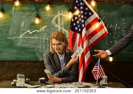 Independence day of usa. Income planning of budget increase policy. Woman with dollar money for bribe. Corruption. American education reform in july 4. Economy and finance. Patriotism and freedom. stock photo
