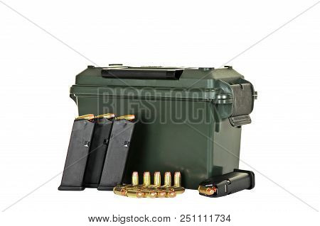 Ammo Box and Four Loaded High Capacity Handgun Magazines with Extra Bullets isolated on WHite Background stock photo