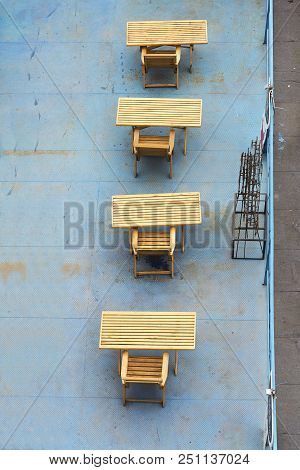 Wooden tables and chairs top view of the summer gazebo. stock photo