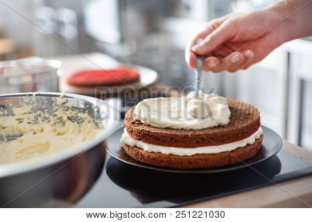 chef making red velvet cake stock photo