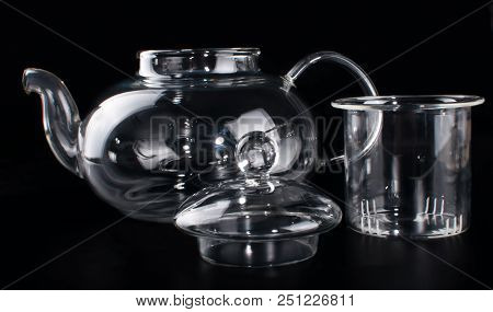 A glass teapot with a teapot inside. stock photo