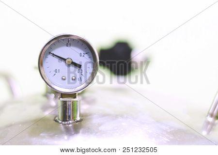Air Pressure gauge of air tank in small factory stock photo