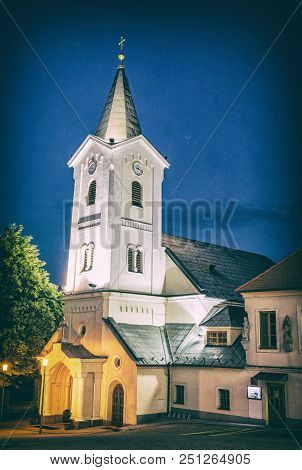 Parish church of the assumption, Nitra, Slovak republic. Religious architecture. Night scene. Cultural heritage. Analog photo filter with scratches. stock photo