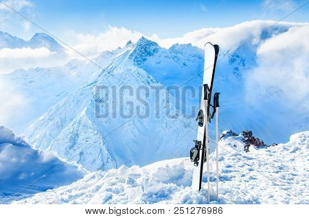 Winter Mountains And Ski Equipment In The Snow. Winter Holidays In Ski Resort
