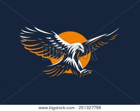 The flying eagle, hawk, falcon. Vector emblem. stock photo