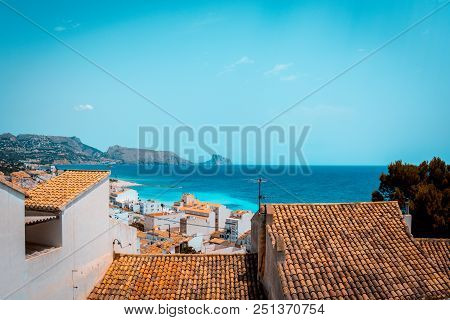 Teal and orange look of typical white houses and the mediterranean sea of the Costa Blanca from Altea, Alicante, Spain stock photo