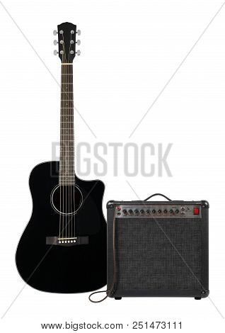 Music and sound - Musical instrument black electro acoustic cutaway guitar, amplifier and cable front view isolated on a white background. stock photo