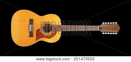 Musical instrument - Front view vintage twelve-string acoustic guitar isolated on a black background. stock photo