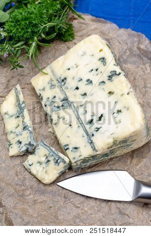 Blue cheese made from cow milk with Penicillinum mold, tasty soft cheese with specific odor close up stock photo
