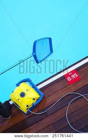Pool cleaner during his work. Cleaning robot for cleaning the botton of swimming pools. Hotel staff worker cleaning the pool. stock photo