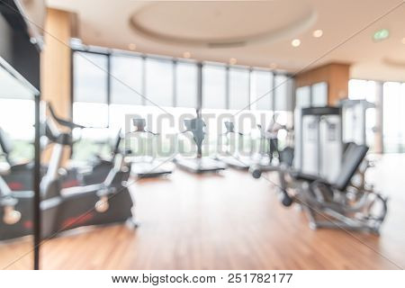 Gym blur background fitness center, workout personal training studio, health club with blurry sports exercise equipment for aerobic, bodybuilding and power strength class stock photo