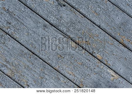Oblique old blue wooden background pattern cracked blue color. Dirty because long people using. Varnished wood textured background stock photo