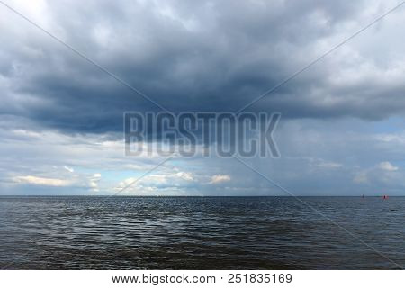 Clouds over the sea pre-storm. Variable marine climate of nature. stock photo