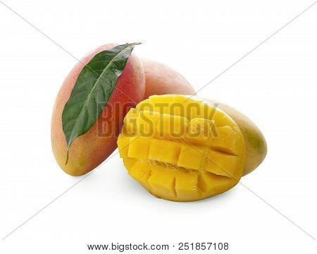 Mango fruit with mango cubes and slices. Isolated on a white background. stock photo
