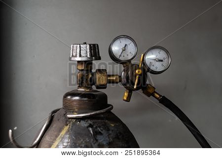 Vintage propane gas tank with pressure meters. Close-up image of compressed cylinder with liquid gas for welding stock photo