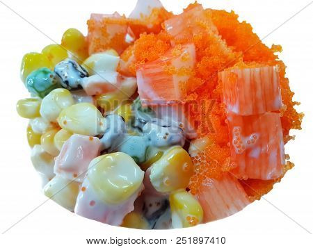 Thai food style,Top view of imitation crab stick salad with shrimp eggs, corn, carrot, nuts and currant isolated on white background, healthy food concept stock photo