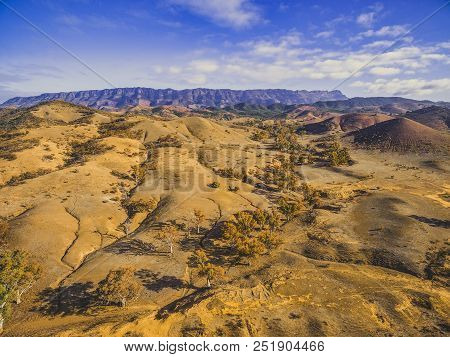 Aerial view of Flinders Ranges mountains and rolling hills with trees in South Australia stock photo
