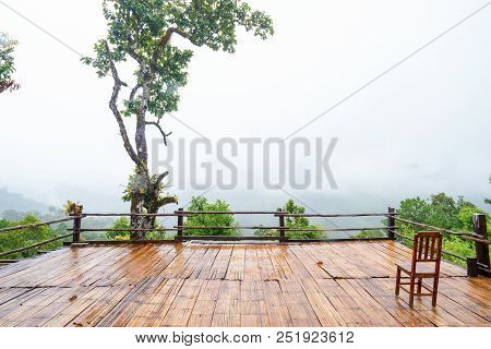 Patio and chair wood Mountain View in Asia, Doi Luang Chiang Dao Chiang Mai Thailand After rain, there is a fog float, covered with green forest, mountain air fresh air landscape nature concept stock photo