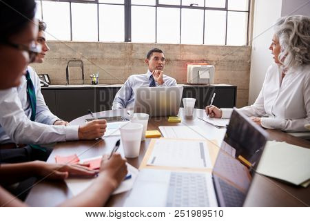 Business team brainstorming in a meeting room stock photo
