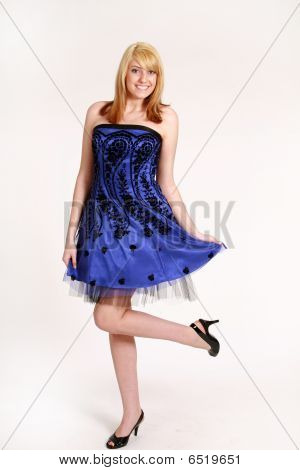 full length of beautiful blonde girl in cocktail dress stock photo