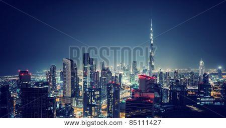 Beautiful Dubai cityscape, bird's eye view on a night urban scene, modern city panoramic landscape,