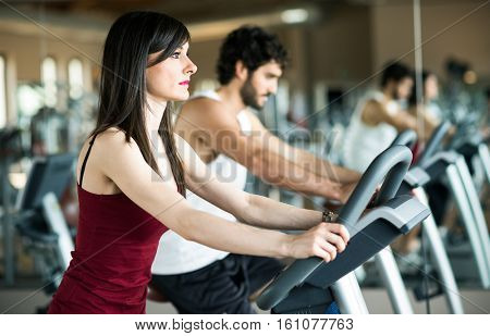 Fit people working out in a gym stock photo