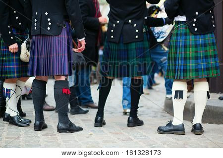 Men in traditional kilts, closeup of legs stock photo