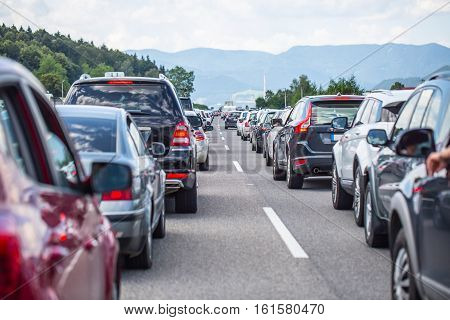 Traffic jam on the highway in the summer holiday period or in a traffic accident. Slow or bad traffic.