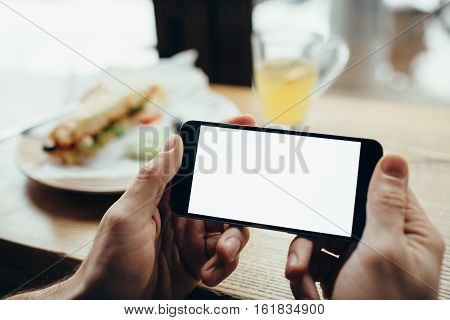 Young Man\'s Hands Holding Mobile Phone