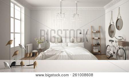 White table top or shelf with minimalistic bird ornament, birdie knick - knack over blurred scandinavian bedroom, modern interior design, 3d illustration stock photo