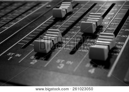 Closeup view of Faders on Professional digital Audio mixing control Console with zero decimal indicators stock photo