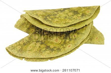 Soft spinach flavour tortilla wraps isolated on a white background stock photo