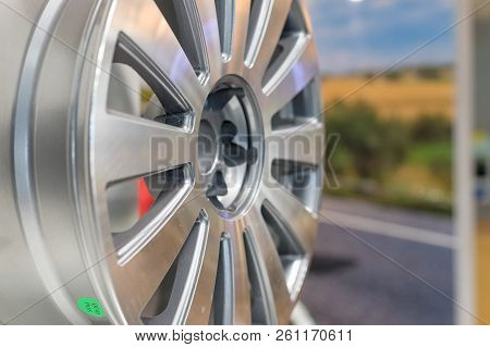 Metal disc wheel for the car at an exhibition.Selective focus.Modern store with alloy wheels and tires, indoors.Aluminum metal wheel rim texture. Car alloy wheel, isolated stock photo