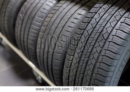tires on sale.New Compact Vehicles Tires Stack. Winter and Summer Season Tires.Close up on all season car tires.Selective focus.Car service. all season car tires stock photo