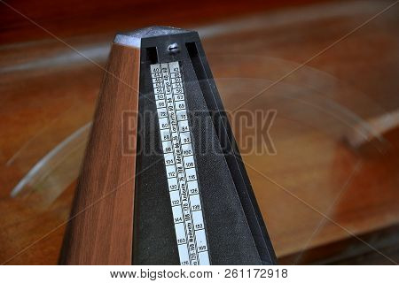 Close up of a vintage metronome with swinging pendulum stock photo