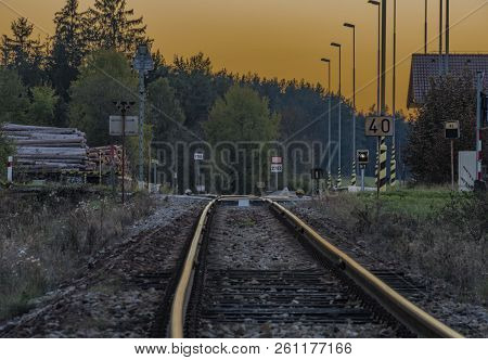 Railroad track near Zbytiny station in sunset time in Sumava national park stock photo
