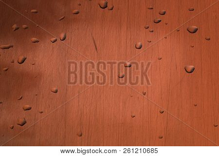 transparent water drops of different shapes on the surface of a scratched non-ferrous metal close-up stock photo