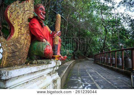 Giant Gate Guardian at temple entrance  to Wat Phra That Doi Tung, Chiang Rai, Thailand. Thai Travel Tourism. stock photo