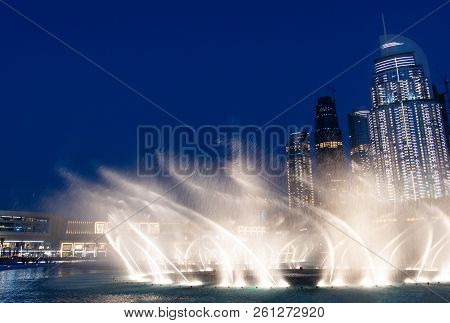 Dubai mall fountain light show at night stock photo